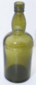 Bottle marked with text Federal Law Forbids Sale or Resuse...
