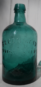 A rare deep blue green Byron Acid Springs bottle, mid 19th century.